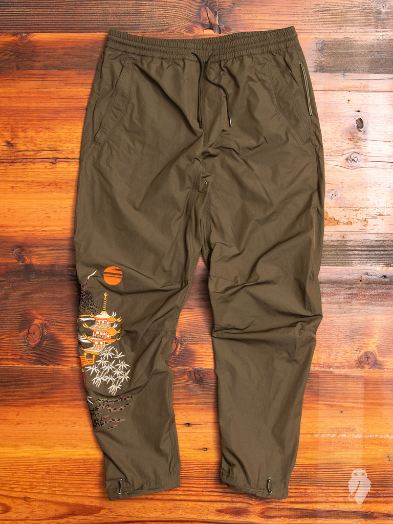 Crane Woven Trackpants in Maha Olive
