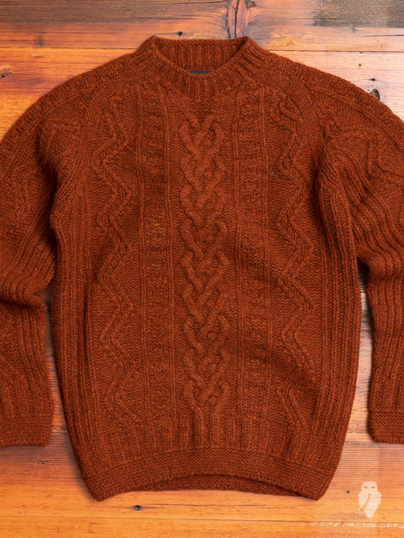 """Super Cult"" Cable-Knit Wool Sweater in Rust"