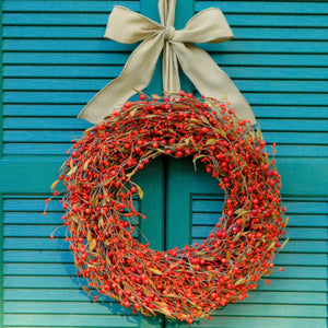 Orange Berry Wreath with Brown Leaves with Bow