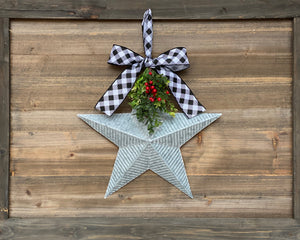 Farmhouse holiday decor, galvanized metal star with bow, Christmas door hanger with greenery and red berries
