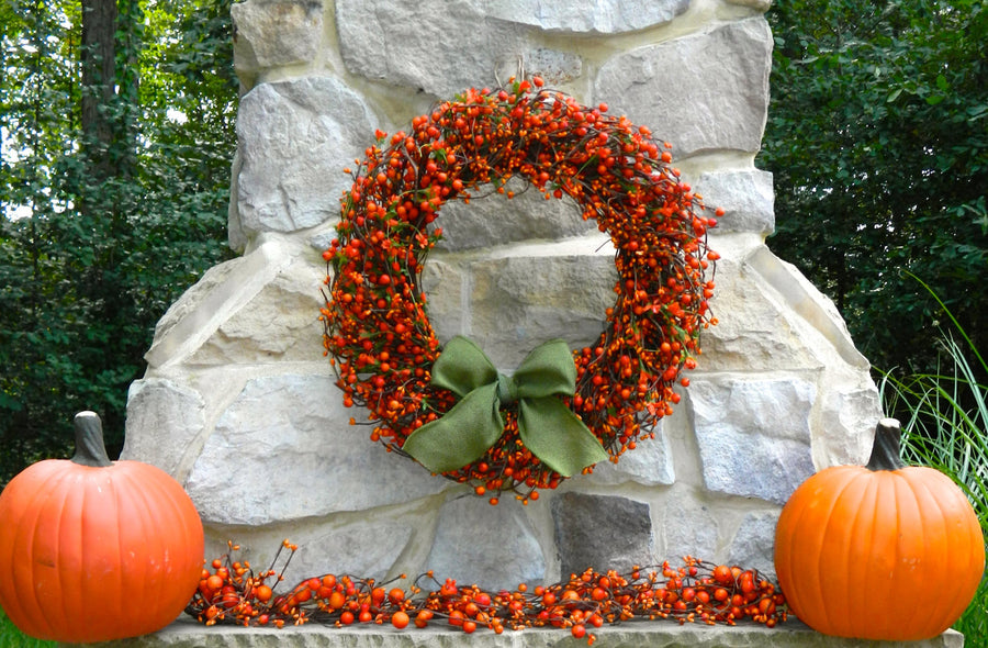 Orange Berry Wreath with Green Leaves and Orange Flowers with Bow