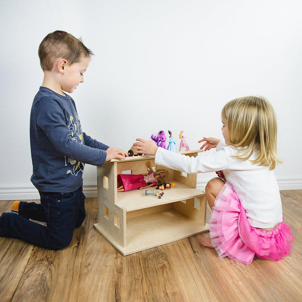 kids playing with wooden dollhouse together