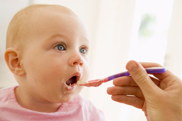 Feeding baby nutritionally.