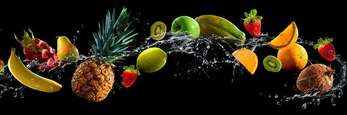 Fruit and water spray on black background