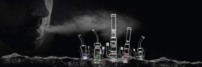 several different types of bongs on black background with smoke