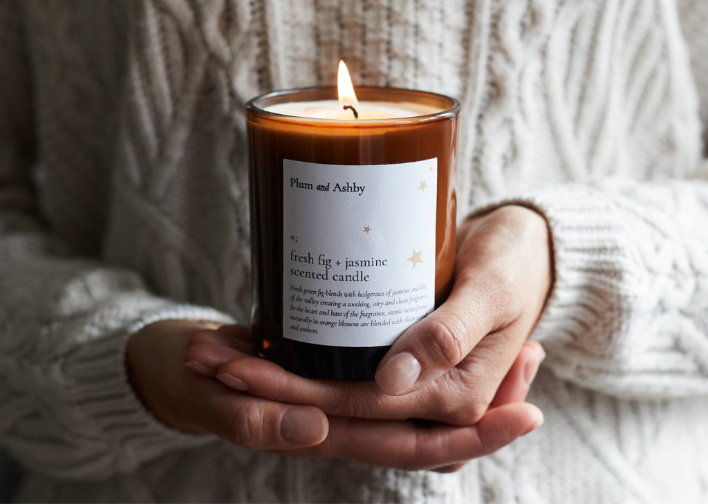 Tommy's and Plum and Ashby Charity Collaboration Candle held to chest in hands