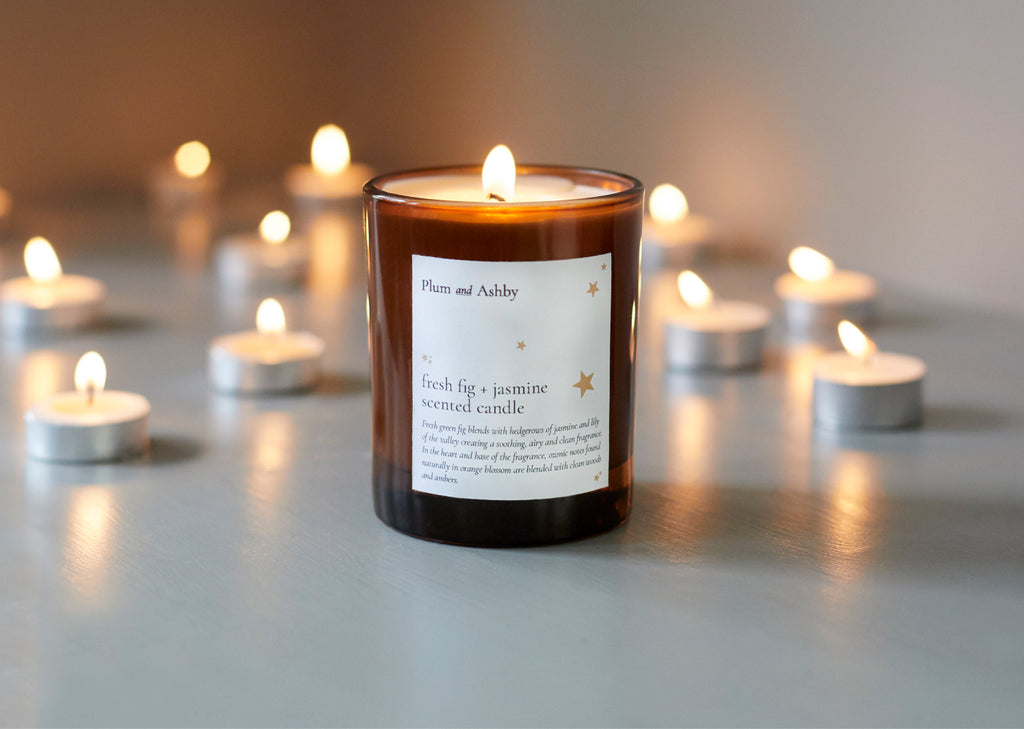 Tommy's and Plum and Ashby Charity Collaboration Candle surrounded by tea lights