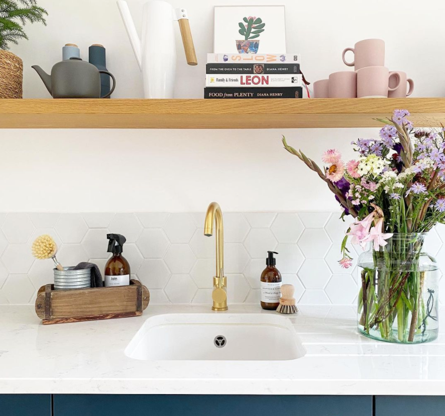 an image from the kitchen of the dunns in orford. Containing spring flowers and plum and ashby hand soap