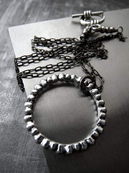 Textured Silver Circle Pendant Necklace on Gunmetal Black Chain