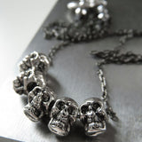 Five Teeny-Tiny Silver Skulls Necklace