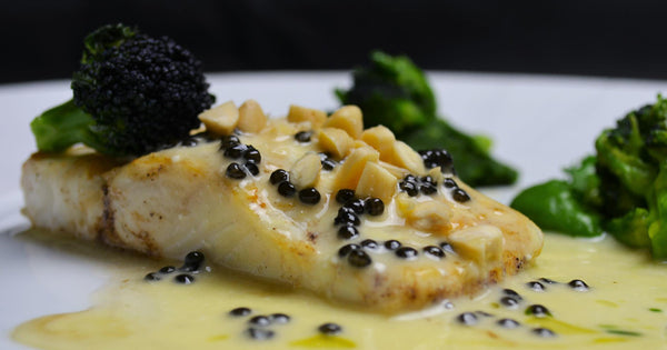 Poached Gigha halibut with smoked almond pesto and Attilus caviar butter sauce