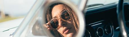 Retro Sunglasses - women wearing volante sunglasses looking in vintage car side mirror