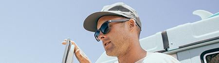 Polarized Wayfarer Sunglasses - man with adventure van wearing headland wayfarer sunglasses on a sunny day