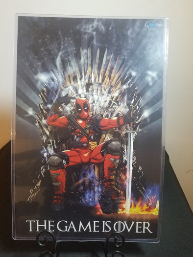 Poster in the likeness of Deadpool from Marvel sitting on a throne with foot crushing a helmet