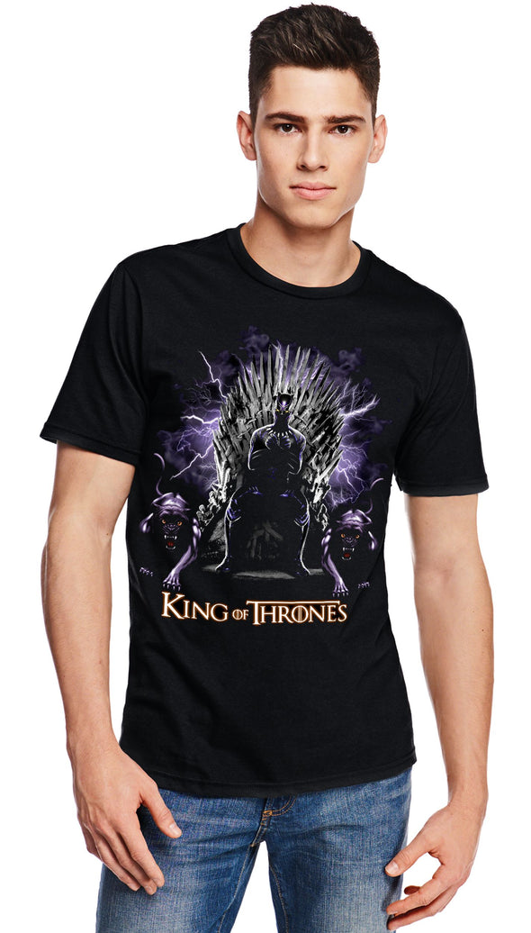 A man wearing a black t-shirt with a image in the likeness of Black Panther from Marvel sitting on a throne