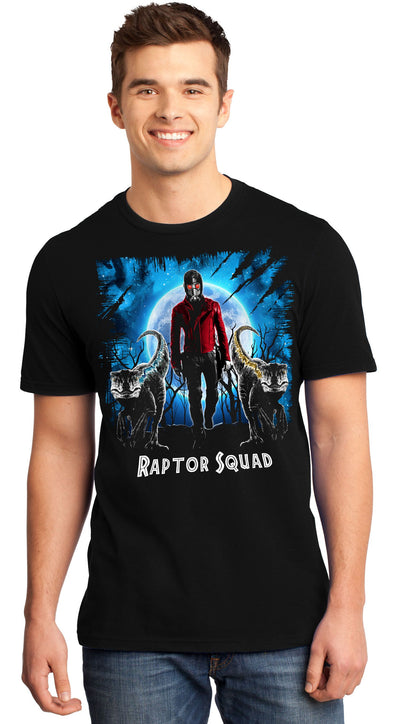A man smiling while wearing a black t-shirt with an image in the likeness of Star-Lord from Marvel with two raptors in front of him