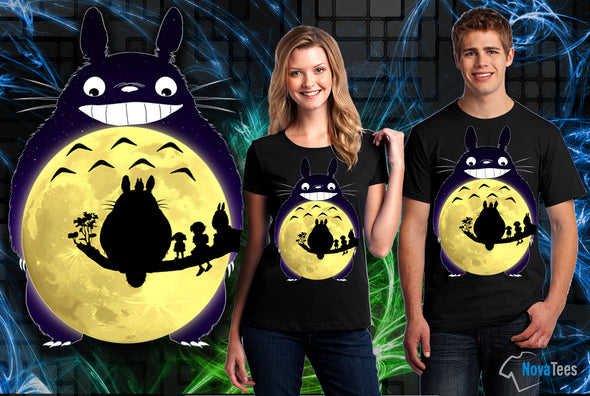A woman and man wearing a black t-shirt with art inspired by Totoro from My Neighbor Totoro with a moon as Totoro's belly