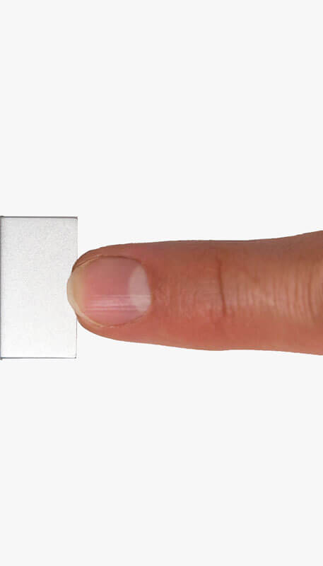 TarDisk Pear hard drive inserted with finger