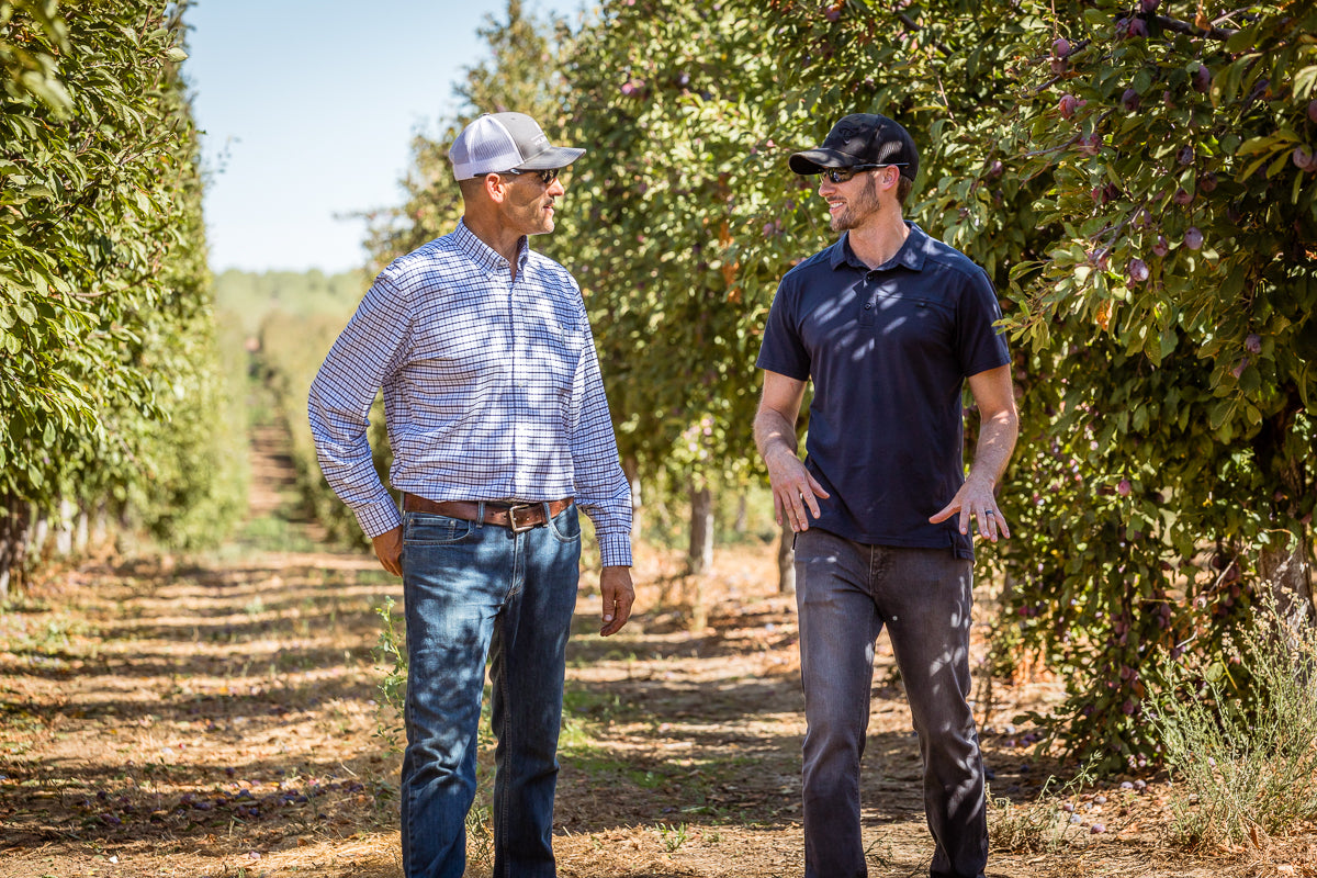 Fourpoints Co-founder Kevin Webber walking Prune orchards with grower Dan Martinez.