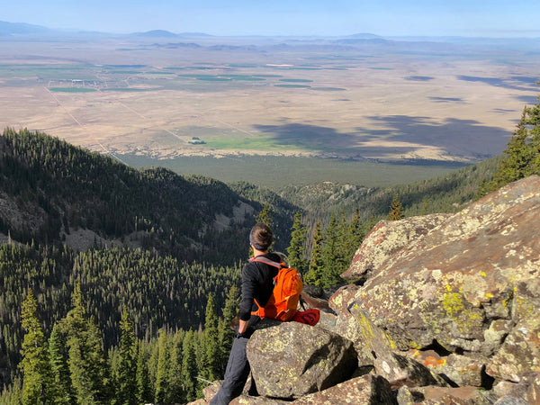 Patrick Webber of Fourpoints Bar taking a break on a Colorado Fourteener to admire the view.