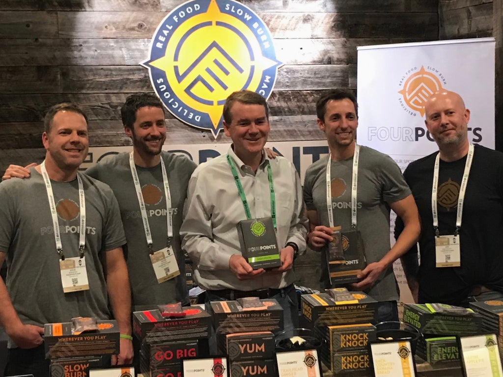 Senator Michael Bennet of Colorado stopping by the Fourpoints Bar booth at the Outdoor Retailer Show in Denver, 2018.