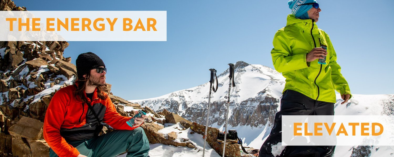 Backcountry skiers holding a Fourpoints Backcountry Banana Bread Bar Saying Go Big with the Best