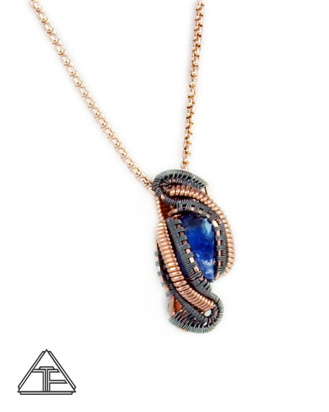Tanzanite Raw Crystal Titanium and Rose Gold Wire Wrapped Pendant