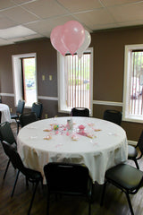 The host decorated the tables with cookie favors and balloons for this sweet baby shower.