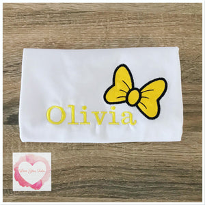 Embroidered yellow bow design