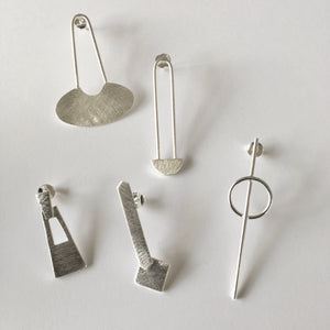 large brushed sterling silver earrings in geometric shapes and stud fittings