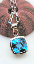 Load image into Gallery viewer, Blue Topaz and Garnet Pendant Ai305