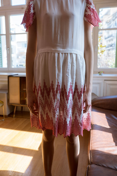 White mini dress with red embroidery