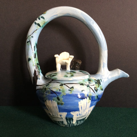 Teapot with White Adirondack Chairs