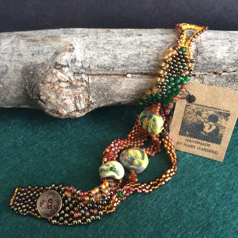 Free Form Peyote Stitch Bracelet with Hand Made Ceramic Beads, Amber and Other Seed Beads, Mary Harding