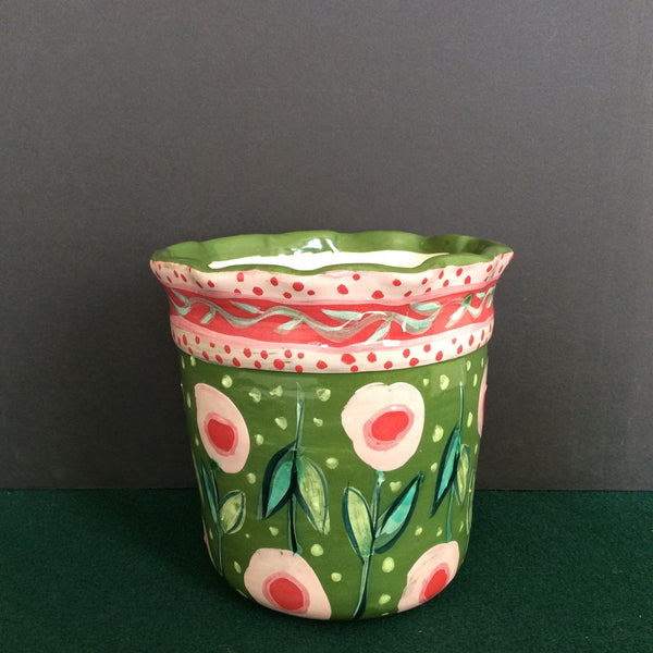 Large green vase with pink flowers