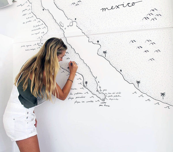 Beachcuties Boutique inspirational interview with Artist and Graphic Designer, Adrianne. Her art captures the allure and love for travelling and keep exploring the hidden gems of our world. Here she talks about her journey so far and how she is living the dream.