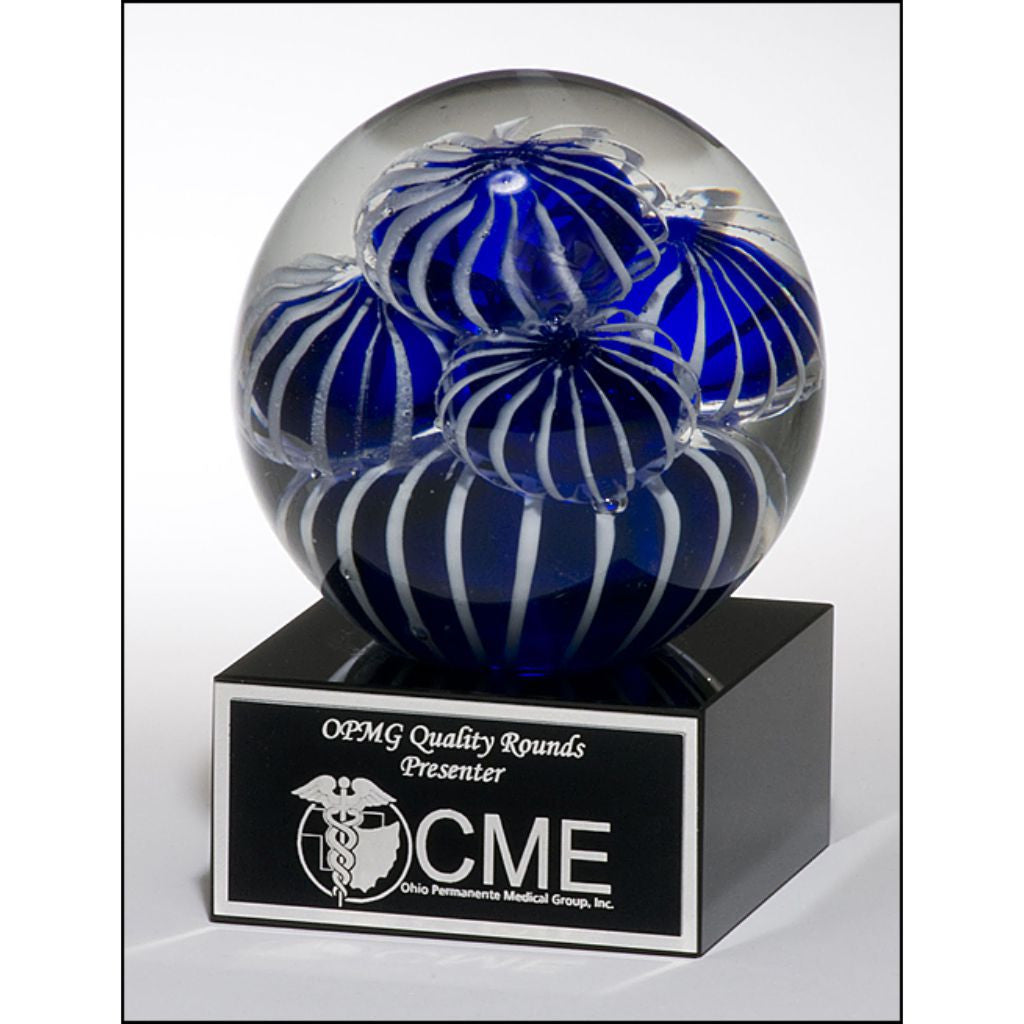 Art glass globe with blue and white sea anemone design