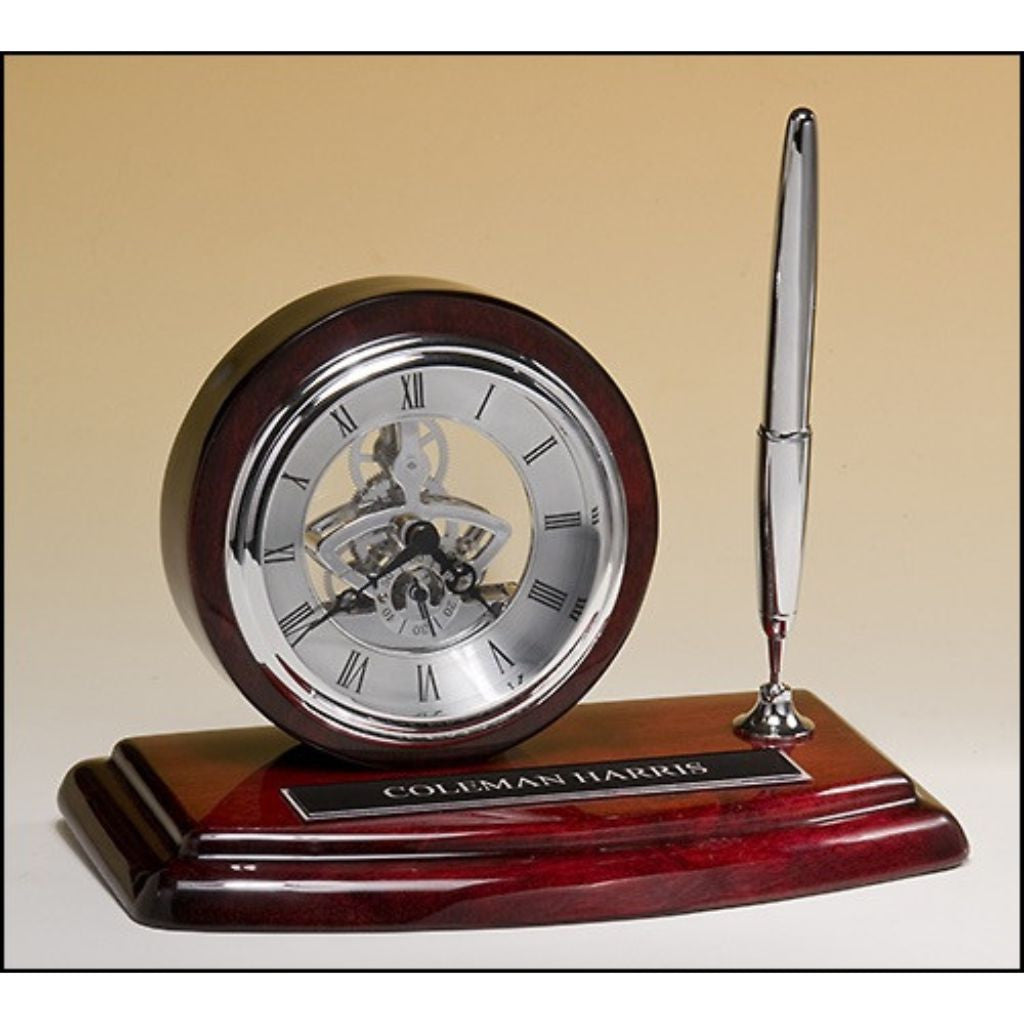 Skeleton desk clock, silver movement and pen with rosewood piano-finish case