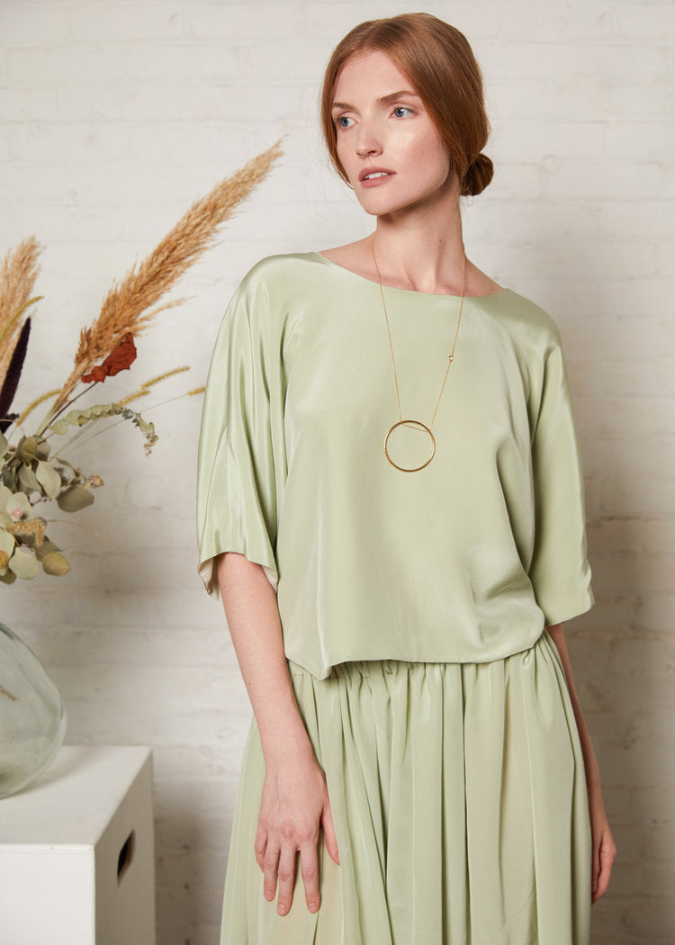 Reversible twist back top in soft green