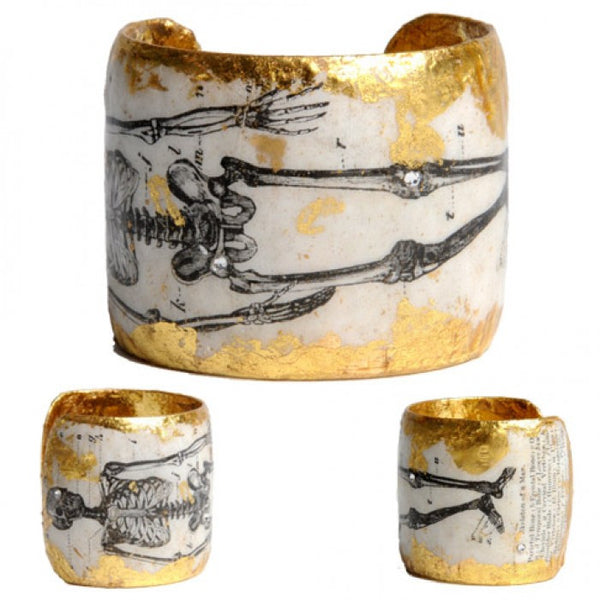 Beautiful Evocatuer 22K gold leaf cuff with 1895 skeletal image, available from Patricia.