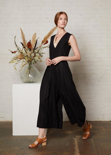 women's romper with long pants and deep v-neck in black