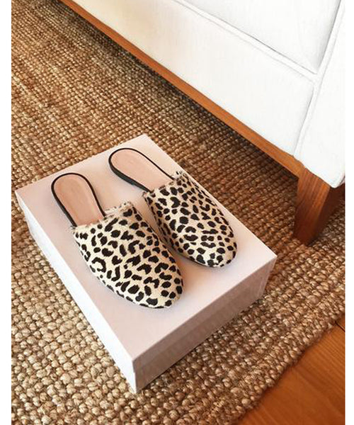 Emerson Fry Leopard Emerson Slides. Find these shoes at PATRICIA. A boutique in Southern Pines, NC dedicated to modern, classic, minimal styles.