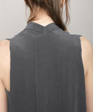 back details of signature silk dress in gray by Szeki