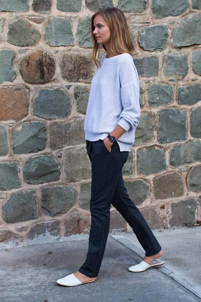 White cotton sweater over jeans
