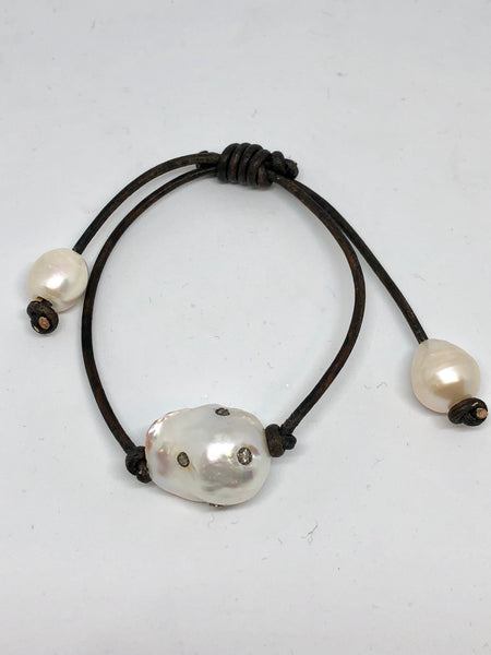 freshwater pearls studded with diamonds on leather cord