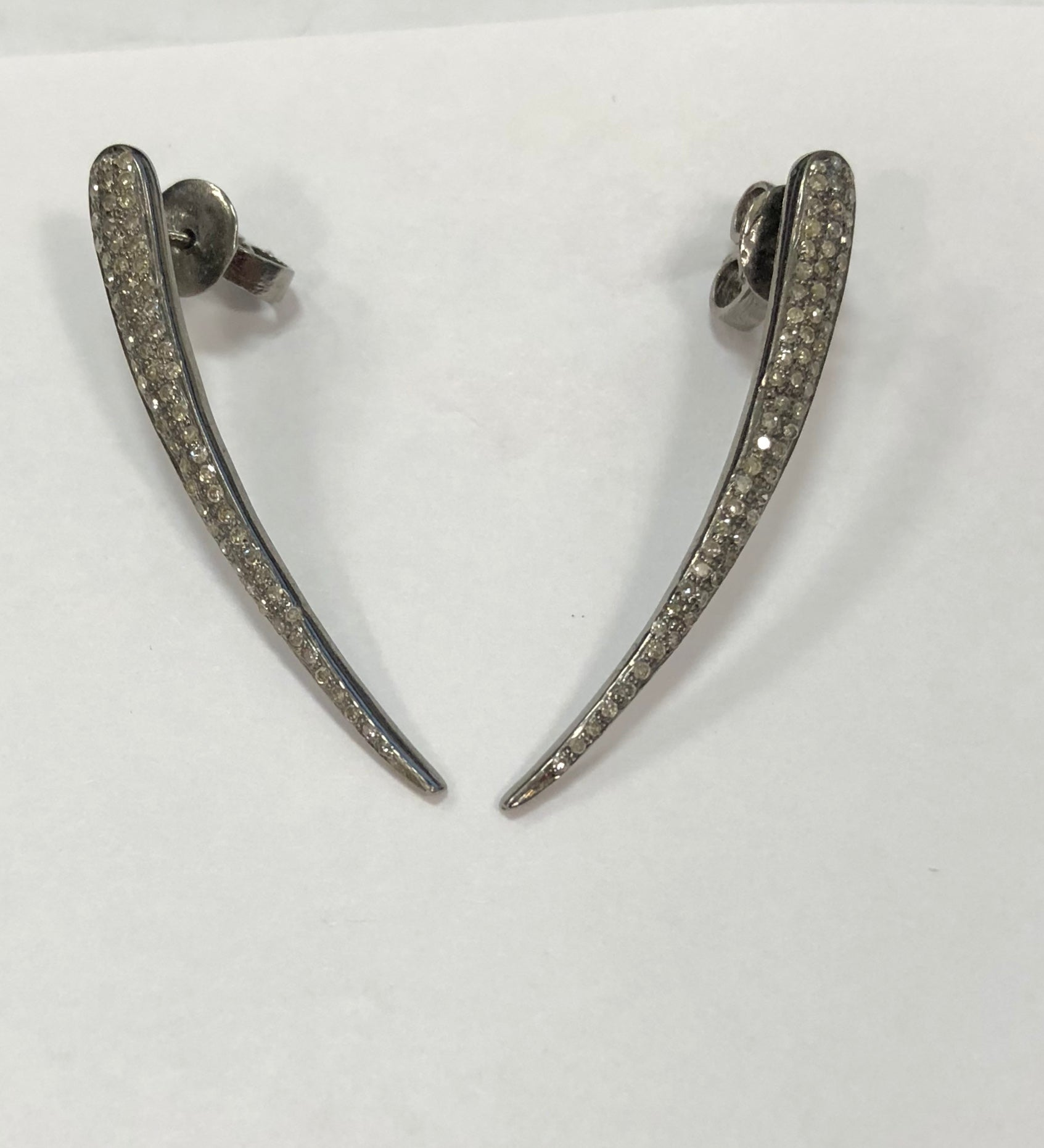 Curved dagger pave earrings
