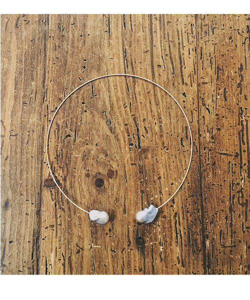 This light and airy necklace features two grey freshwater pearls on a wire choker. The wire is Sterling Silver.