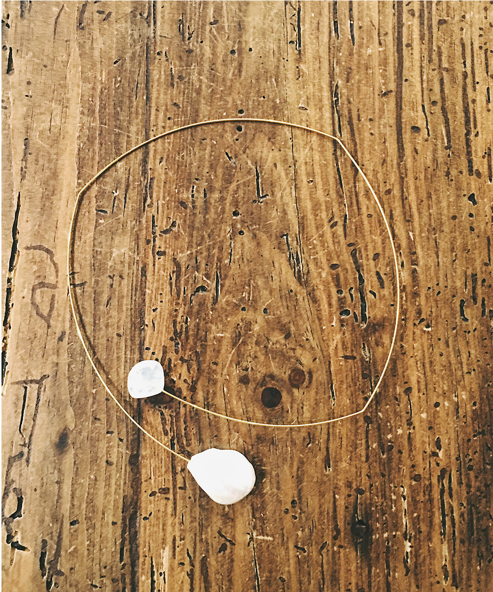 This light and airy necklace features a freshwater pearl and rainbow moonstone floating on a wire choker.