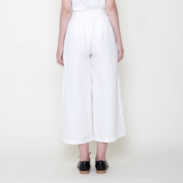 wide legged white linen trousers viewed from the rear