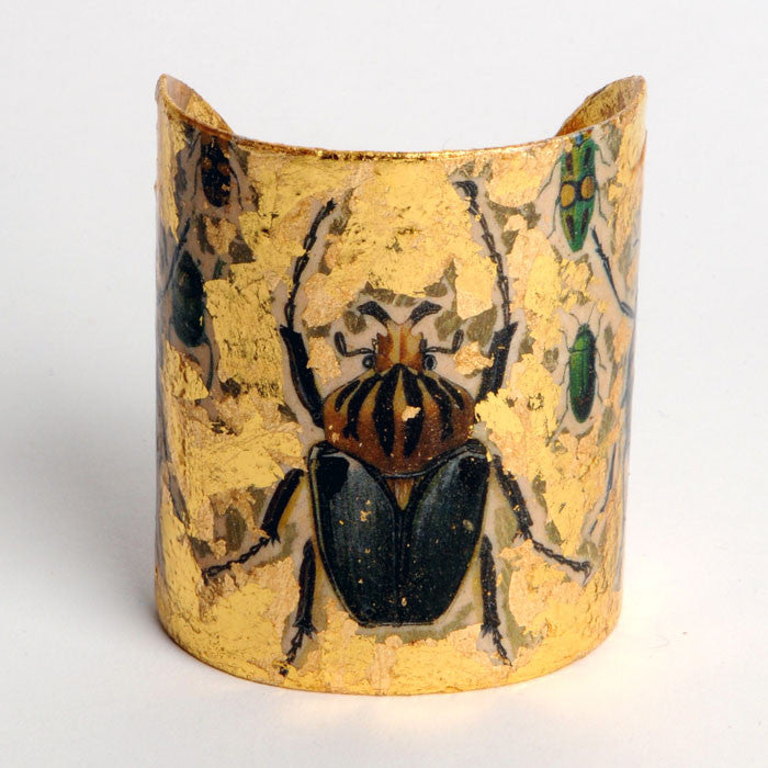 Beautiful Evocateur gold leaf cuff, featuring images of various garden beetles, available at Patricia